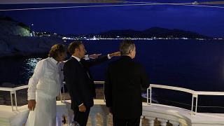French President Emmanuel Macron, center, French chef Gerald Passedat, left, and Italian Prime Minister Mario Draghi meet before a dinner in Marseille, France.