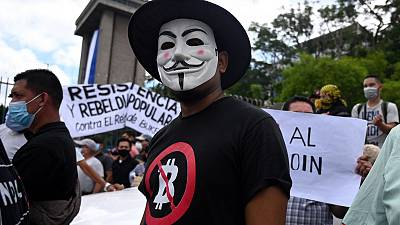 An anti-Bitcoin protest on the streets of San Salvador.