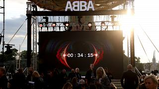 People look at the screen, at the ABBA Voyage event at Grona Lund, in Stockholm, Sweden, Sept. 2, 2021.