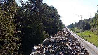 Waste piled up on the abandoned A601 motorway near Liege