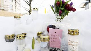 Candles, flowers and notes are placed in a park where the 16-year-old boy died.