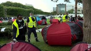 Migrant camp near Paris dismantled and people evacuated by bus