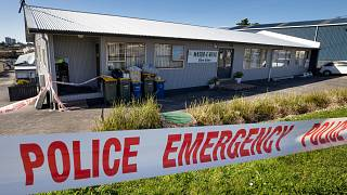 Police security tape outside a mosque in Auckland, New Zealand, Saturday, Sept. 4, 2021.