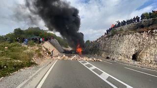 Demonstrators near a road block of burning tyres in Cetinje, Montenegro.