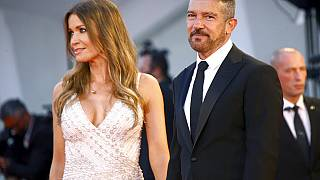 Antonio Banderas, right, and Nicole Kimpel pose for photograph upon arrival at the premiere of the film 'Official Competition' during the 78th Venice Film Festival.