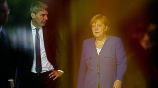 In this June 13, 2019, file photo, German Chancellor Angela Merkel, right, talks to then foreign policy advisor Jan Hecker, left.