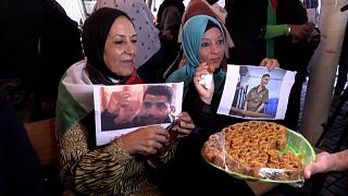 Families of the prisoners inside the Red Cross building in Gaza