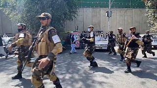 Taliban use gunfire to break Kabul protests.