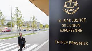 In this file photo taken on Monday, Oct. 5, 2015 a woman walks by the entrance to the European Court of Justice in Luxembourg.