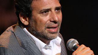المخرج المصري خالد يوسف في حفل افتتاح مهرجان دبي السينمائي الدولي، في دبي، في 6 ديسمبر 2013