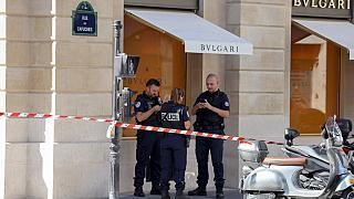 French Police Nationale officers form a security cordon on Place Vendome.