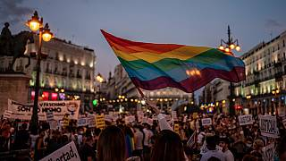 People gather at a protest at Sol square in Madrid.