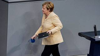 German Chancellor Angela Merkel leaves the lectern after her speech in the plenary session in the German Bundestag in Berlin, Germany, Tuesday, Sept.7, 2021.