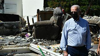 US President Joe Biden tours a neighbourhood affected by Hurricane Ida in Manville, New Jersey on September 7, 2021.