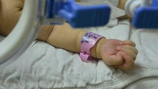Both newborn baby girls had been placed in incubators in 2002.