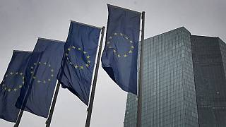 Flags of the European Union flutter in front of the headquarters of the European Central Bank (ECB) in Frankfurt am Main, western Germany, on March 12, 2020.