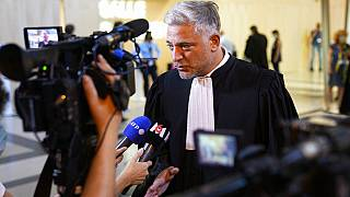 Xavier Noguerras, a lawyer for defendant Mohammed Amri, a suspected accomplice of Salah Abdeslam, answers reporters outside the special courtroom Wednesday, Sept. 8, 2021
