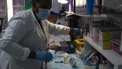 Laboratory technicians test a blood sample for HIV infection at the Reproductive Health and HIV Institute (RHI) in Johannesburg