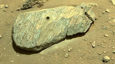 A hole in the rock on Mars that the Perseverance Rover drilled to collect the sample.