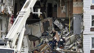Members of the Emergency services work at the site of a gas explosion.