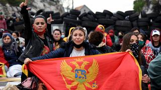Demonstrators gather at a barricade set up to block access roads to Cetinje during a protest against the inauguration of the new head of the Serbian Orthodox Church