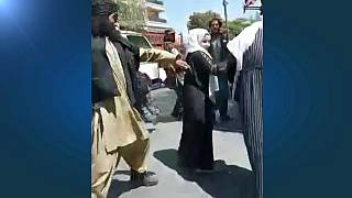 Taliban forces use whips to hit women at a protest in Kabul on September 8, 2021.