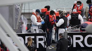 People thought to be migrants who made the crossing from Francedisembark in Dover after being picked up in the Channel by a British border force vessel, Aug. 13, 2021.