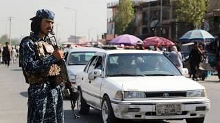Taliban fighter stand guards in the city of Kabul, Afghanistan, Saturday, Sept. 4, 2021.
