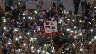 People stage a protest against the COVID-19 vaccination pass in Rome in July.