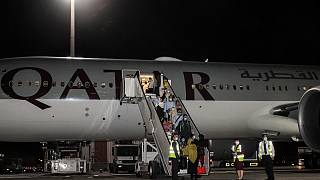 Evacuees from Afghanistan arrive at Hamad International Airport in Qatar's capital Doha on the first flight carrying foreigners out of Kabul since the US withdrawal. 9/9/21.