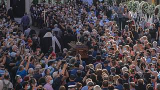 Pallbearers carry coffin of Greek composer Mikis Theodorakis outside the Metropolitan church, prior to his funeral service, in Chania, Crete island, Greece, September 9 2021