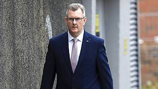 In this Friday, May 14, 2021 file photo, Democratic Unionist Party member Jeffrey Donaldson MP leaves the party HQ in Belfast after voting took place to elect a new leader.