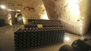 In this Wednesday, Oct. 16, 2013 photo, bottles of champagne are piled up inside the Veuve Clicquot Ponsardin cellars in Reims, eastern France