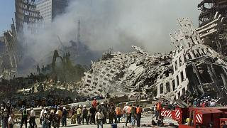 Rescue workers comb through debris for survivors at the site of the World Trade Centre in New York, on September 13, 2001.