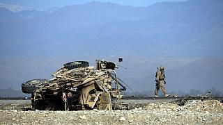A US soldiers inspects the site of a suicide attack targeting foreign troops in Jalalabad on November 13, 2014.