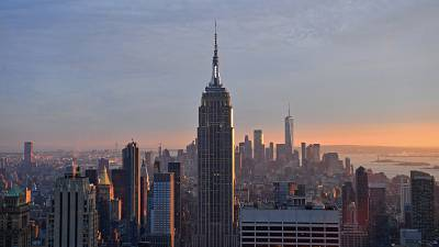 The Empire State Building and the 'Freedom Tower' are seen during sunset from the Rainbow Room in New York, on September 9, 2021.