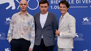 Mateusz Gorski, from left, Jan P. Matuszynski and Tomasz Zietek  at the photo call for the film 'Leave No Traces' during the Venice Film Festival, Sept. 9, 2021.