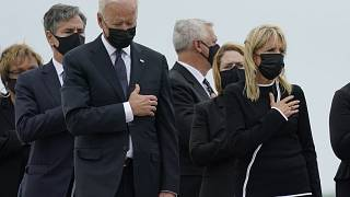 FILE: President Joe Biden watch as a carry team moves the transfer case containing the remains of Navy Corpsman Maxton W. Soviak during a casualty return, Aug. 29, 2021.