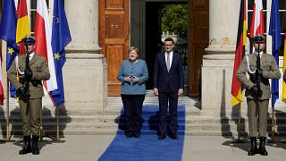 German Chancellor Angela Merkel, left, meets Poland's Prime Minister Mateusz Morawiecki in Warsaw, Poland, Saturday, Sept.11, 2021.