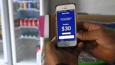A person shows a screen while using the Salvadoran government's electronic wallet Chivo, after bitcoins were put into circulation throughout the country.
