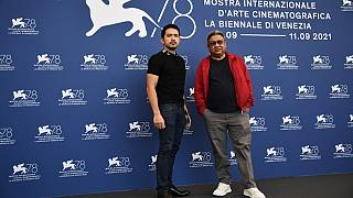 """Filipino actor Dennis Trillo (L) and Filipino director Erik Matti attend a photocall for the film """"On the Job: The Missing 8"""" at the Venice Film Festival on September 10, 2021"""