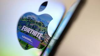 This file illustration photo shows the opening screen of Epic Games' Fortnite reflecting onto the Apple logo of the back of an I-mac in Los Angeles on May 3, 2021.