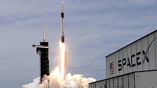 A SpaceX Falcon 9 rocket with a Dragon 2 spacecraft lifts off on pad 39A at the Kennedy Space Center for a re-supply mission to the International Space Station from Cape Canav