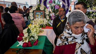 People mourn next to the coffin with the remains of Mexican environmentalist Homero Gomez González, during his funeral in El Rosario village, Mexico.