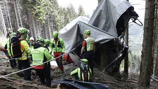 Rescuers search for evidence in the wreckage of a cable car after it collapsed near the summit of the Stresa-Mottarone line in the Piedmont region, Italy, May 26, 2021.