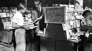 School children look at school books in a bookstore in Paris, September, 1946