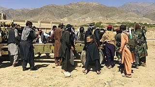 Taliban soldiers gather with weapons and machinery in Panjshir province northeastern of Afghanistan, Wednesday, Sept. 8, 2021.
