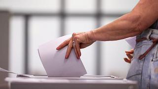 A vote is cast at a polling station during the Saxony-Anhalt state elections in Wittenberg.