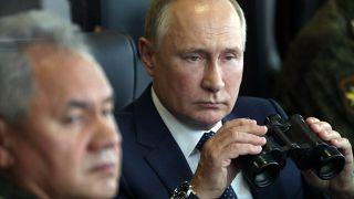 Russian President Vladimir Putin and Russian Defense Minister Sergei Shoigu watch joint Russia-Belarus military drills, in the Nizhny Novgorod region, Russia, Sept. 13, 2021.