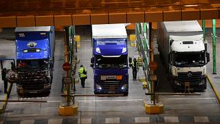 In this file photo taken on December 31, 2020 after disembarking from a ferry, lorries undergo checks at the port of Dover on the south-east coast of England.